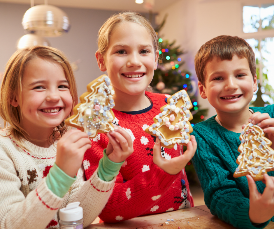 Children holding holiday cookies